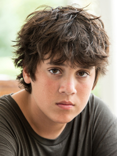 young teen boy with messy hair